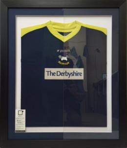 Framed DCFC Shirt with Art Glass Left Hand Side.