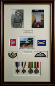 Military Memorabilia includes Medals Badges & Photographs in a multi mount