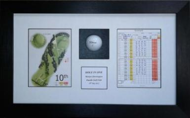 Framed Golf Ball and Score Card commemorating that hole in one.
